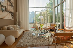 Eames chair and ottoman sets the mood amid the glass walls