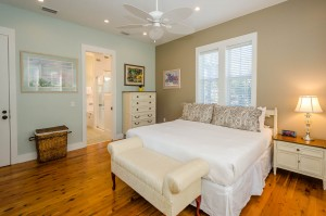 The tranquil 1st floor master bedroom is a welcome retreat.